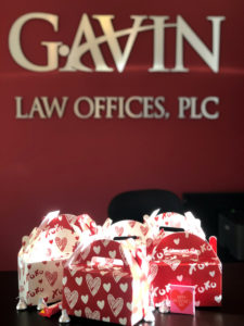 Valentine's themed treat boxes sit atop the front desk at Gavin Law Offices